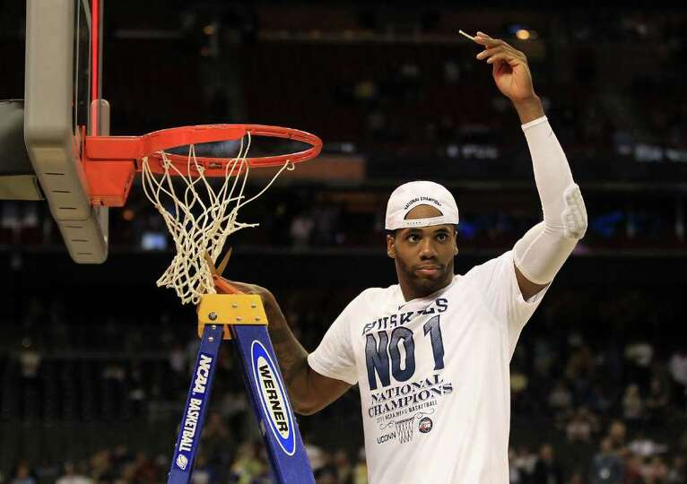 HOUSTON, TX - APRIL 04:  Alex Oriakhi #34 of the Connecticut Huskies cuts down the net after defeati
