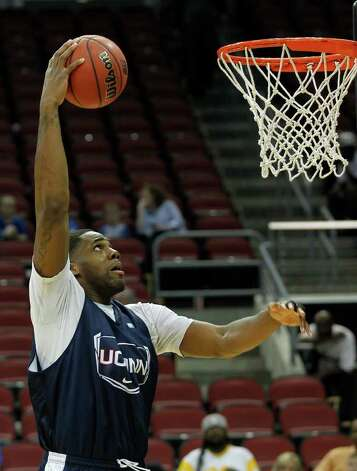Connecticut forward Alex Oriakhi (34) shoots during basketball practice in Louisville, Ky., Wednesday, March 14, 2012. Connecticut is scheduled to play Iowa State in an NCAA tournament second-round college basketball game on Thursday. (AP Photo/Dave Martin) Photo: Dave Martin/Associated Press / AP