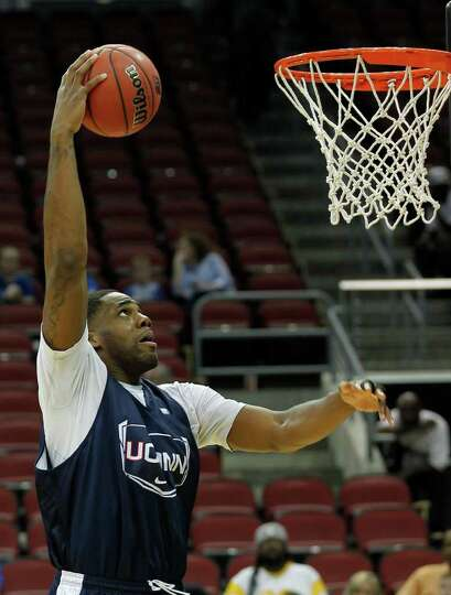 Connecticut forward Alex Oriakhi (34) shoots during basketball practice in Louisville, Ky., Wednesda