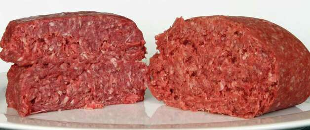 "This Thursday, March 15, 2012 photo shows ground beef containing what is derisively referred to as ""pink slime,"" or what the meat industry calls ""lean, finely textured beef,"" right, and pure 85% lean ground beef, in Concord, N.H.  Under a change announced Thursday by the U.S. Department of Agriculture, districts that get food through the government's school lunch program will be allowed to say no to ground beef containing the ammonia-treated filler and choose filler-free meat instead. The low-cost filler is made from fatty meat scraps that are heated to remove most of the fat, then treated with ammonium hydroxide gas to kill bacteria such as E. coli and salmonella. (AP Photo/Jim Cole) Photo: Jim Cole"