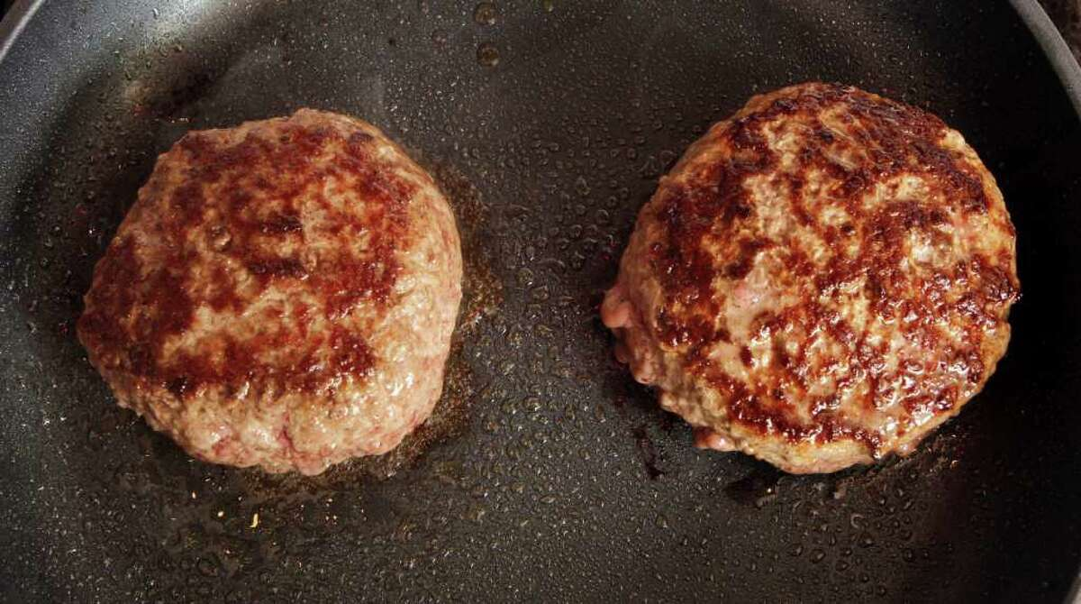 A hamburger made from ground beef containing what is derisively referred to as