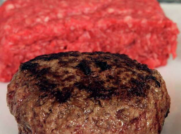 A hamburger made from pure 85% lean ground beef is ready for tasting Thursday, March 15, 2012 in Concord, N.H.  Under a change announced Thursday by the U.S. Department of Agriculture, districts that get food through the government's school lunch program will be allowed to say no to ground beef containing the ammonia-treated filler and choose filler-free meat instead. The low-cost filler is made from fatty meat scraps that are heated to remove most of the fat, then treated with ammonium hydroxide gas to kill bacteria such as E. coli and salmonella. (AP Photo/Jim Cole) Photo: Jim Cole