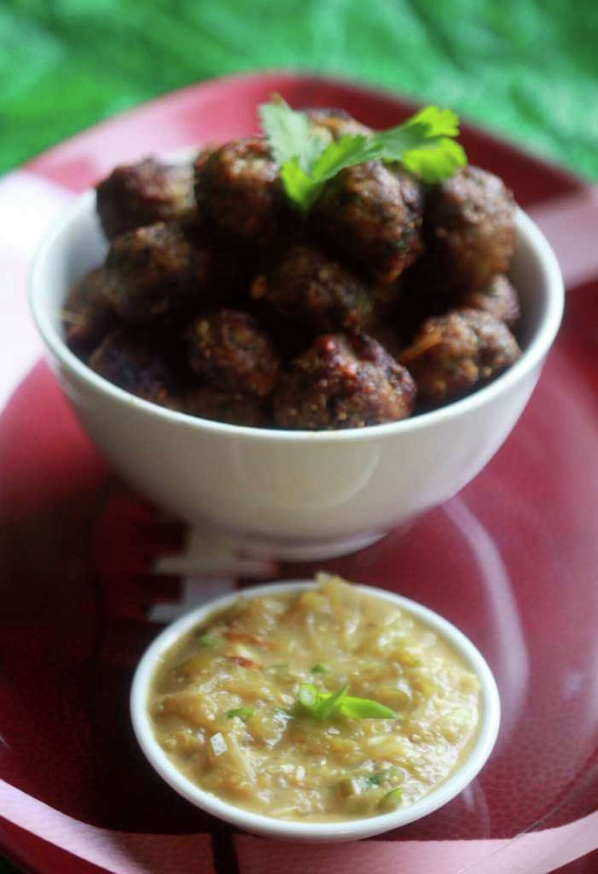 Chicken verde meatballs makes a healthier party snack than traditional meatballs. (Regina H. Boone Detroit Free Press/MCT)