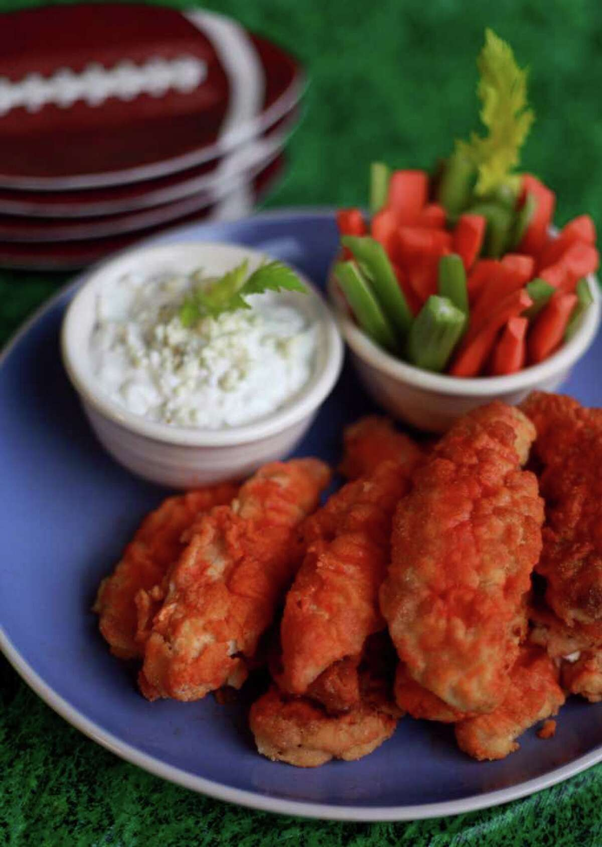 Baking chicken wings makes them a healthier snack but it is still the fattiest part of the chicken, so also substitute lower fat dips for a healtheir party snack. (Regina H. Boone/Detroit Free Press/MCT)