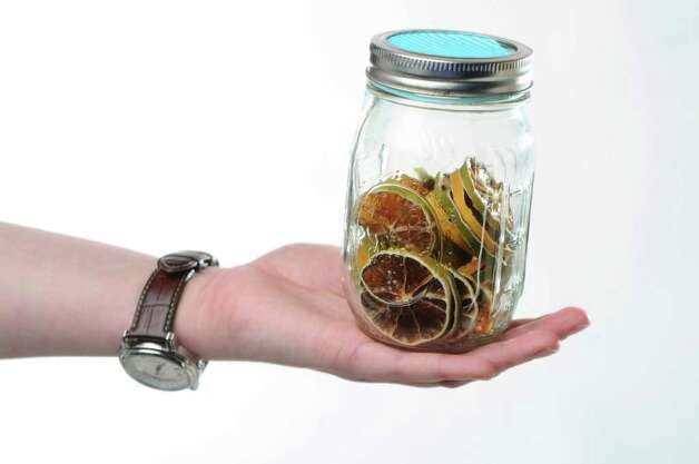 A jar of dried limes for a food swap from a member of the From Scratch Club, in the Times Union photography studio on Tuesday March 13, 2012 in Colonie, N.Y.   (Philip Kamrass / Times Union ) Photo: Philip Kamrass / 00016763A