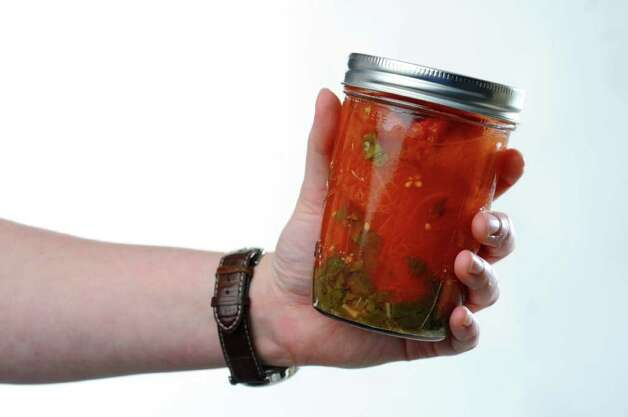 A jar of San Marzano tomatoes with basil,  for a food swap from a member of the From Scratch Club, in the Times Union photography studio on Tuesday March 13, 2012 in Colonie, N.Y.   (Philip Kamrass / Times Union ) Photo: Philip Kamrass / 00016763A