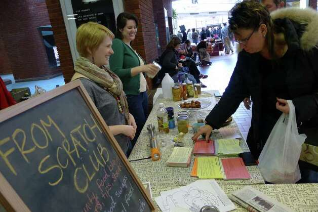 Christine Hmiel,left, and Deanna Fox of The From Scratch Club at the Troy Farmers Market in Troy,NY Saturday March 10, 2012 ( Michael P. Farrell/Times Union ) Photo: Michael P. Farrell / 00016751A
