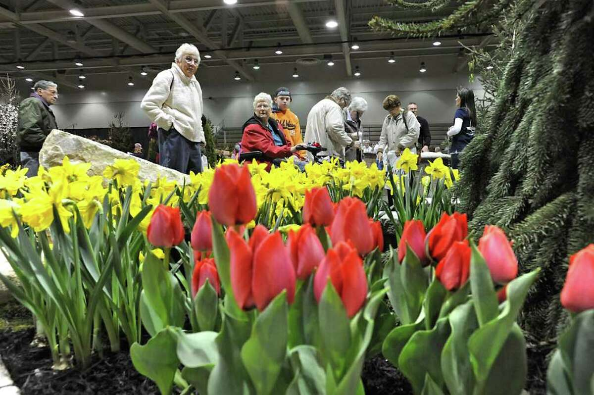 People check out flowers and landscape designs at the annual Capital District Garden & Flower Show at Hudson Valley Community College in Troy, NY on Friday, March 25, 2011. (Lori Van Buren / Times Union)