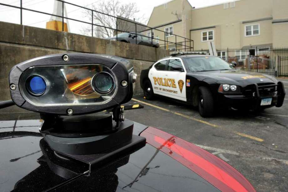 A camera mounted on the trunk of a Bridgeport police cruiser is part of a license plate recognition system, seen here at Bridgeport police headquarters, in Bridgeport, Conn. March 21st, 2012. Photo: Ned Gerard / Connecticut Post
