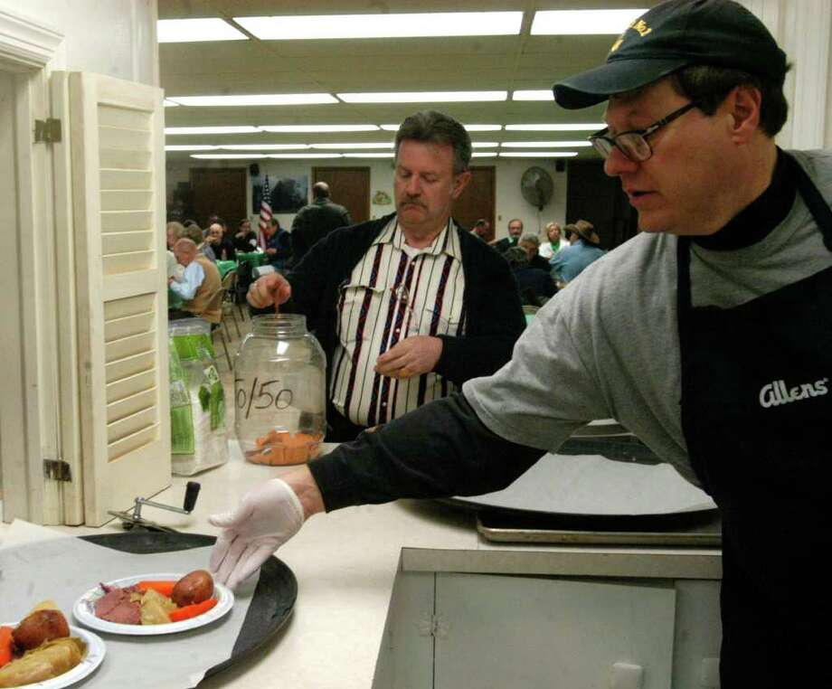 SPECTRUM/Peter Dolce might well have been the busiest person in the house March 10 as he fulfilled his kitchen chores for the St. Peter's Masonic Lodge's annual St. Patrick's dinner/cabaret. Photo: Norm Cummings