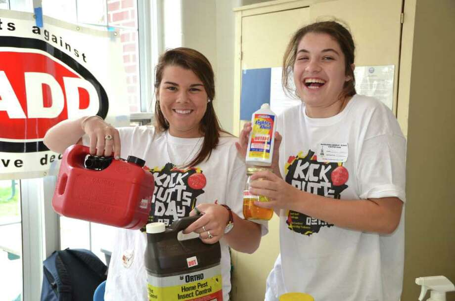 SADD members Sloane Clarke and Caroline Feehan from Darien High School showed Middlesex Middle School students just exactly what is in a cigarette, on Kick Butts Day, Wednesday, March 21. Photo: Jeanna Petersen Shepard