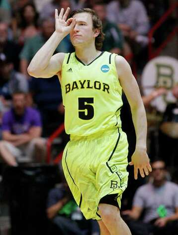 Baylor guard Brady Heslip (5) gestures after hitting a three-point basket during the first half of an NCAA tournament third-round college basketball game against Colorado, Saturday, March 17, 2012, in Albuquerque, N.M. Baylor won 80-63. Photo: AP