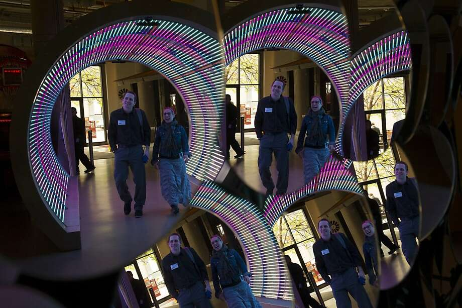 "Zynga employees walk through the ""time tunnel"" at the game company's San Francisco headquarters. Photo: David Paul Morris, Bloomberg"