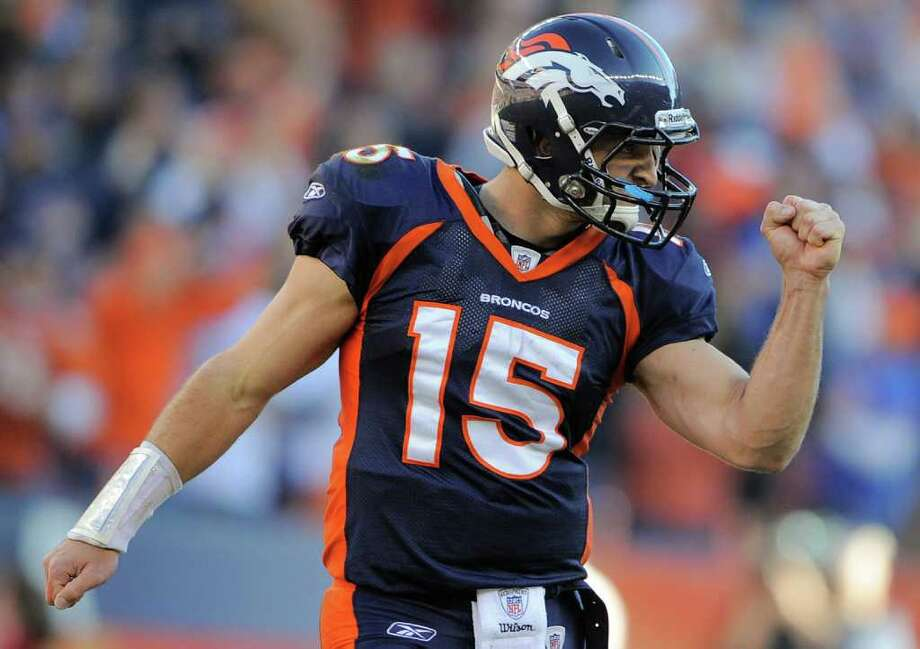 FILE - In this Dec. 18, 2011 file photo, Denver Broncos quarterback Tim Tebow (15) reacts after a touchdown run by Denver Broncos running back Lance Ball (35) against the New England Patriots in an NFL football game,  in Denver.  Tebow was traded to the New York Jets, Wednesday, March 21, 2012. Photo: AP