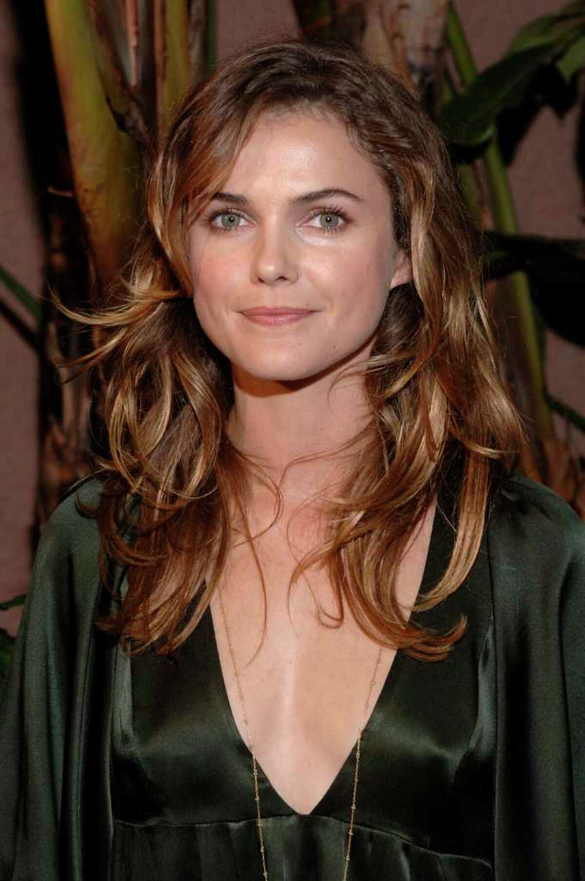 ** FILE ** Actress Keri Russell arrives for the Children's Defense Fund's annual Los Angeles Beat the Odds Awards held at the Beverly Hills Hotel in this Oct. 12, 2006, file photo in Beverly Hills, Calif. Russell, who starred in TV's