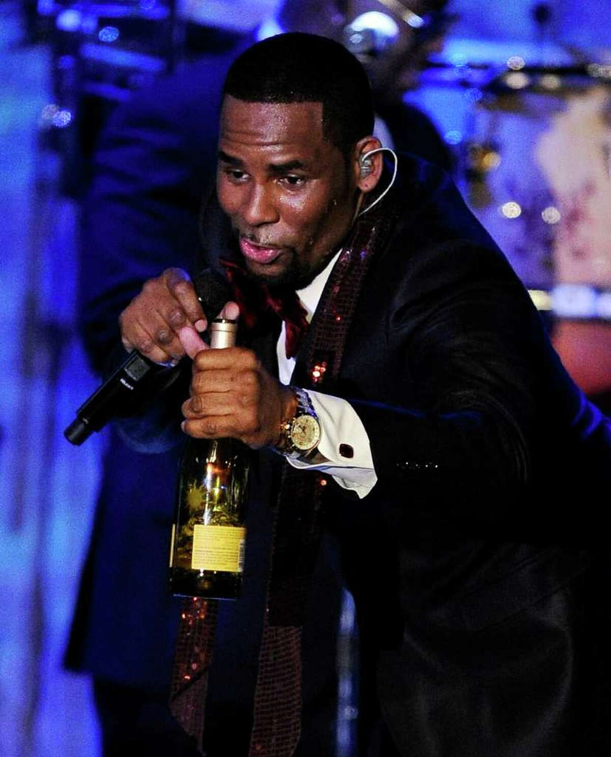 In this Feb. 12, 2011 photo, R. Kelly performs at the pre-Grammy gala & salute in Beverly Hills, Calif. The outrageous musical series started off as five videos for the R&B singer's dramatic cliffhanger songs in 2007. It quickly became a cult classic and he added more chapters and put the accompanying videos on a DVD also teamed up with IFC to premiere it. (AP Photo/Mark J. Terrill)