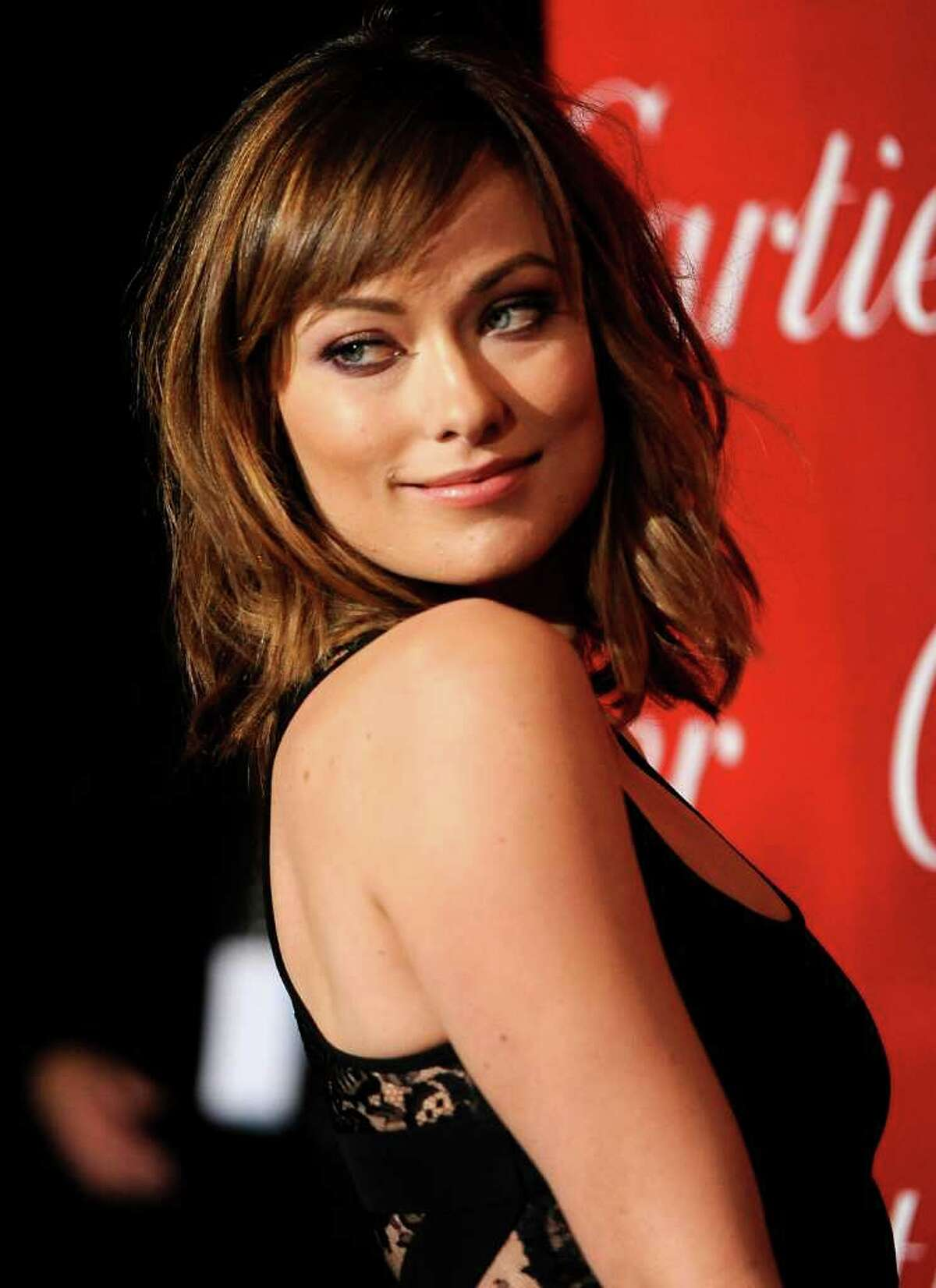 FILE - In this Jan. 7, 2012 file photo, actress Olivia Wilde poses at the 2012 Palm Springs International Film Festival Awards Gala in Palm Springs, Calif. Wilde will host the EIF Revlon Run/Walk in New York on May 5. (AP Photo/Chris Pizzello, file)