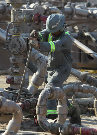An oilfield employee works at a Talisman Energy fracking site near Cotulla, Texas. Talisman Energy is working with Norwegian energy company Statoil to extract oil and gas from the Eagle Ford shale formation in south central Texas. (Wednesday September 7, 2011) JOHN DAVENPORT/SAN ANTONIO EXPRESS-NEWS/jdavenport@express-news.net Photo: JOHN DAVENPORT, SAN ANTONIO EXPRESS-NEWS / HEARST NEWSPAPERS