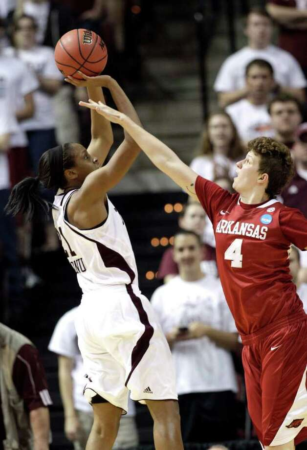 Texas A&M's Adaora Elonu (21) shoots over Arkansas' Sarah Watkins (4) during the second half of an NCAA tournament second-round women's college basketball game Monday, March 19, 2012, in College Station, Texas. Texas A&M beat Arkansas 61-59. (AP Photo/David J. Phillip Photo: AP