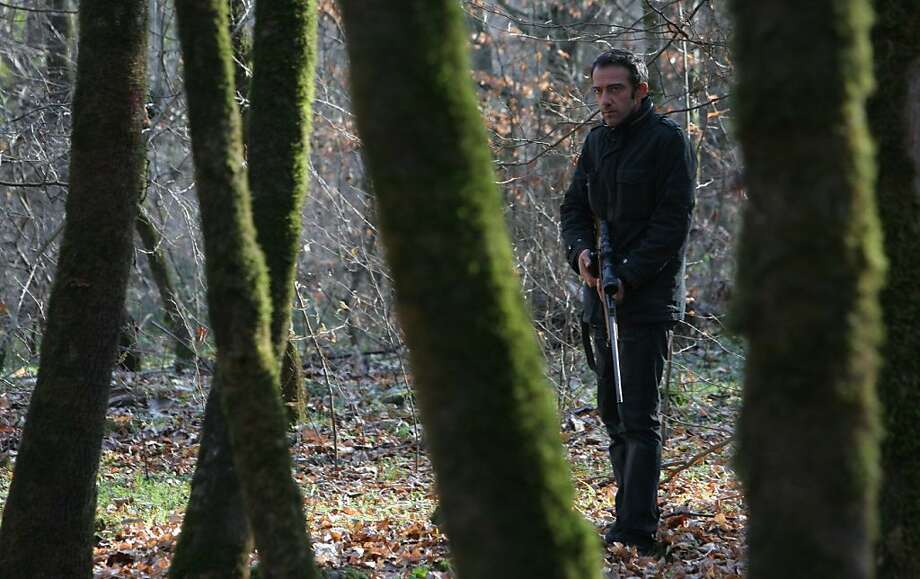 """Rafi Pitts directs """"The Hunter,"""" in which he plays Ali, a man who randomly kills two police officers in an act of vengeance for his wife and daughter, is captured by two other officers, with whom he is lost in a forest. Photo: Olive Films"""