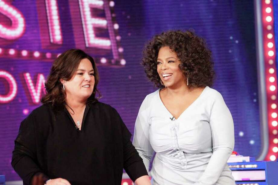 "FILE - In this Oct. 10, 2011 file image released by Harpo, Inc., Oprah Winfrey, right, is shown with host Rosie O'Donnell during the debut of ""The Rosie Show,"" in Chicago. Oprah Winfrey's struggling network, OWN, is laying off 30 workers and restructuring its operations in New York and Los Angeles.  On Friday, March 16,  OWN announced the curtain on ""The Rosie Show"" will be on March 30, after five months on the air. Photo: AP"