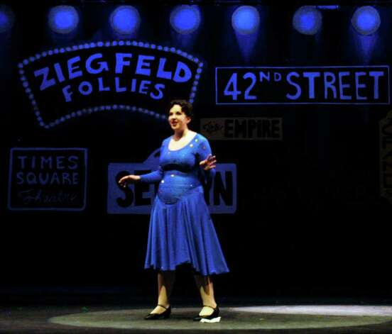 "SPECTRUM/Gwen Trott, in her role as Dorothy Brock, performs on stage during New Milford High School rehearsal for its all-school musical, ""42nd Street,"" March 19, 2012. Photo: Norm Cummings"
