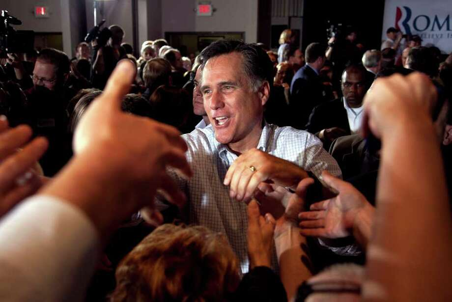 Republican presidential candidate, former Massachusetts Gov. Mitt Romney shakes hands with supporters during a campaign stop at an American Legion post in Arbutus, Md., Wednesday, March 21, 2012. Photo: AP
