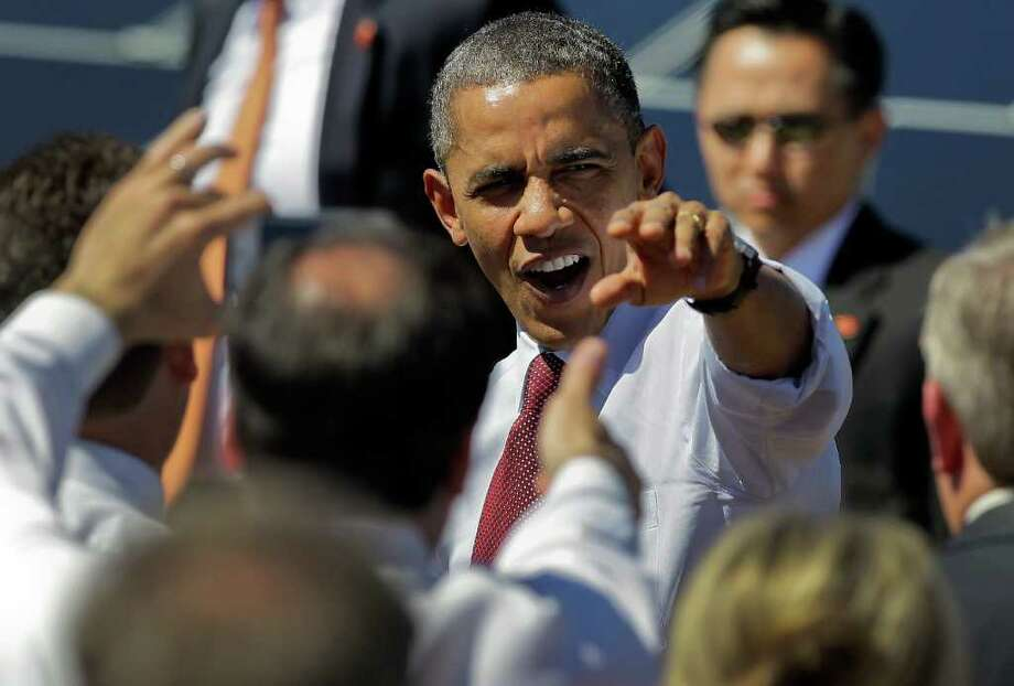President Barack Obama greets supporters after speaking at Sempra's Copper Mountain Solar 1 facility, Wednesday, March 21, 2012, in Boulder City, Nev. Photo: AP
