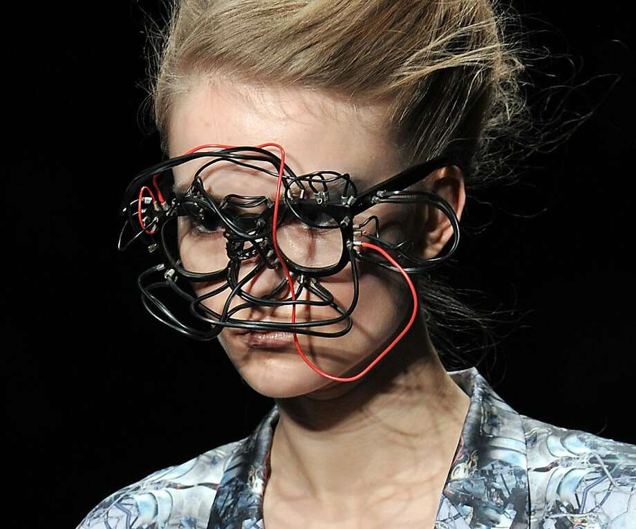 A model displays a creation, designed by Japanese designer Shiho Shiroma during the Shiroma 2012-13 autumn and winter collection in Tokyo on March 21, 2012 as a part of Tokyo Fashion Week.TOPSHOTS     AFP PHOTO / Yoshikazu TSUNO (Photo credit should read YOSHIKAZU TSUNO/AFP/Getty Images) Photo: Yoshikazu Tsuno, AFP/Getty Images
