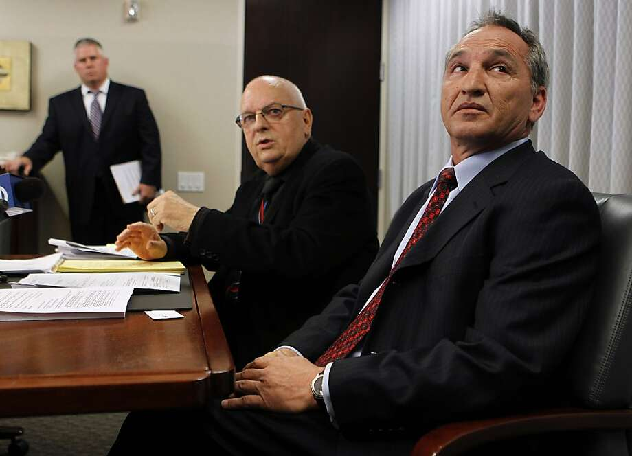 Former Contra Costa County deputy district attorney Michael Gressett (right) sits with attorney Gary Gwilliam in Oakland, Calif. on Wednesday, March 21, 2012, as they announce that they're filing a lawsuit against Gressett's former employers claiming he was maliciously investigated and accused of raping a co-worker. Photo: Paul Chinn, The Chronicle