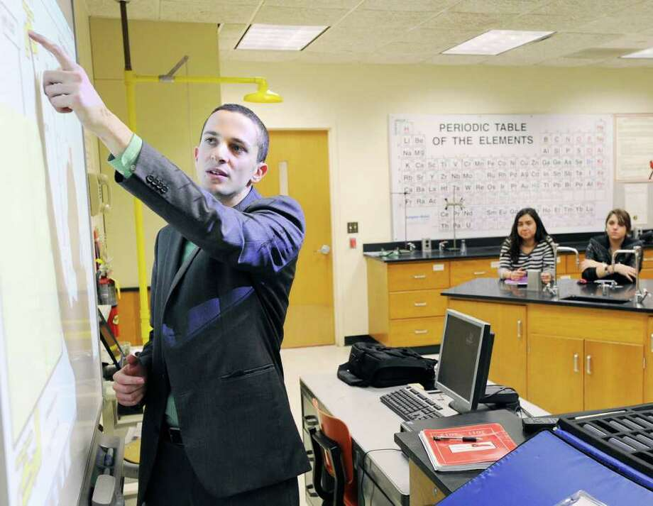 Matt Myers teaches a chemistry class at Greenwich High School Thursday, March 8, 2012. Myers is one of 10 finalists in the Great American Teach-Off, a contest that will award $10,000 to one innovative middle or high school teacher. Photo: Bob Luckey / Greenwich Time