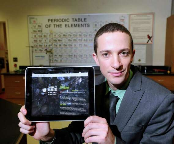 Matt Myers, a science teacher at Greenwich High School, holds an iPad featuring the web page of his educational software company, Slate and Tablets, at the school Thursday March 8, 2012. Myers is one of 10 finalists in the Great American Teach-Off, a contest that will award $10,000 to one innovative middle or high school teacher. Photo: Bob Luckey / Greenwich Time