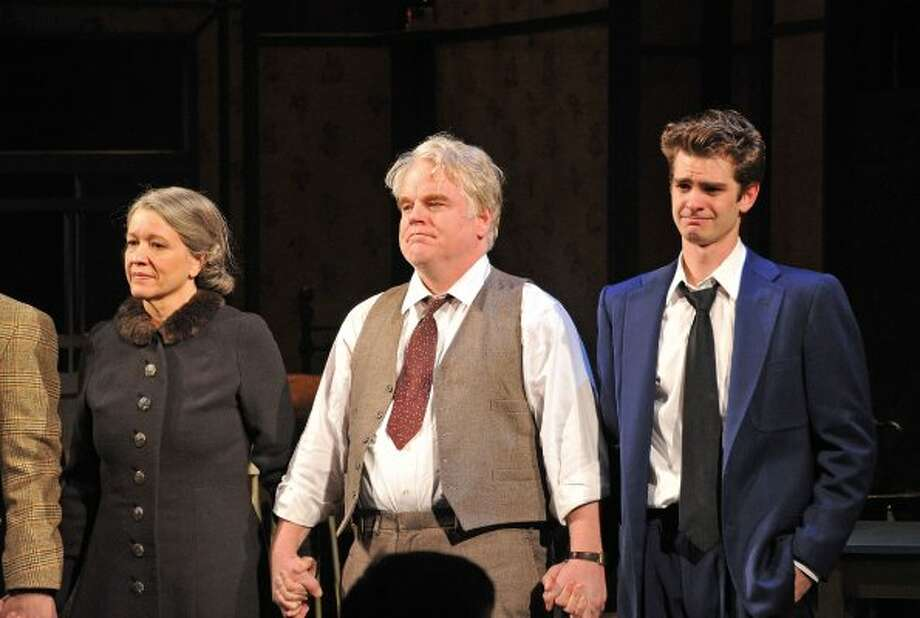"Linda Emond, Philip Seymour Hoffman and Andrew Garfield take a curtain call at the Broadway opening night of ""Death of a  Salesman"" on March 15 in New York City. (Mike Coppola / Getty Images)"