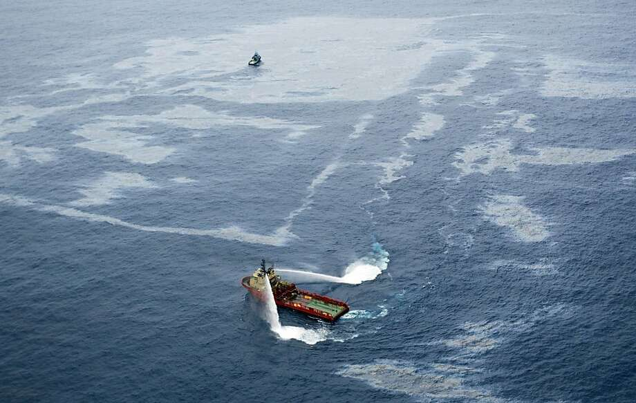 """(FILES) Handout picture released by Agencia O Globo showing a supply boat working around an oil spill at the Frade field, located in the Atlantic Ocean some 370 Km northeast of Rio de Janeiro, on November 18, 2011. Rio de Janeiro's public prosecutor's office on March 21, 2012 took before justice U.S. oil giant Chevron and 17 people, among them its president in Brazil, for """"environmental offence"""", following an offshore oil spill that sttarted last November and still continues.   AFP PHOTO/Agencia O GLOBO/Marcia Foletto -- RESTRICTED TO EDITORIAL USE-NO MARKETING-NO ADVERTISING CAMPAIGNS-MANDATORY CREDIT 'AFP PHOTO/Agencia O GLOBO/Marcia Foletto ' -DISTRIBUTED AS A SERVICE TO CLIENTS BRAZIL OUT - INTERNET OUT (Photo credit should read Marcia Foletto/AFP/Getty Images) Photo: Marcia Foletto, AFP/Getty Images"""