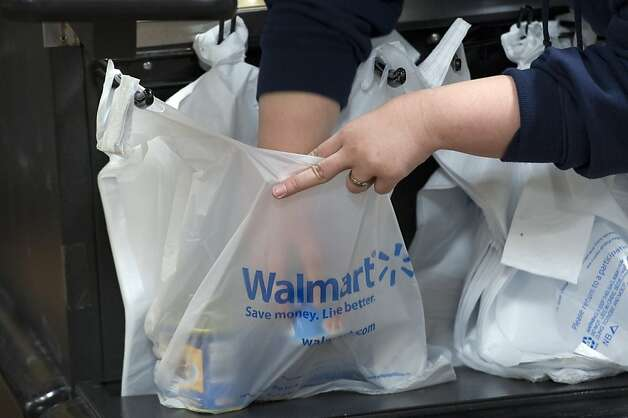 An employee bags merchandise at a Wal-Mart Stores Inc. location in American Canyon, California, U.S., on Thursday, Feb. 16, 2012. Wal-Mart Stores Inc. is scheduled to release fourth-quarter earnings on Feb. 21. Photographer: David Paul Morris/Bloomberg Photo: David Paul Morris, Bloomberg