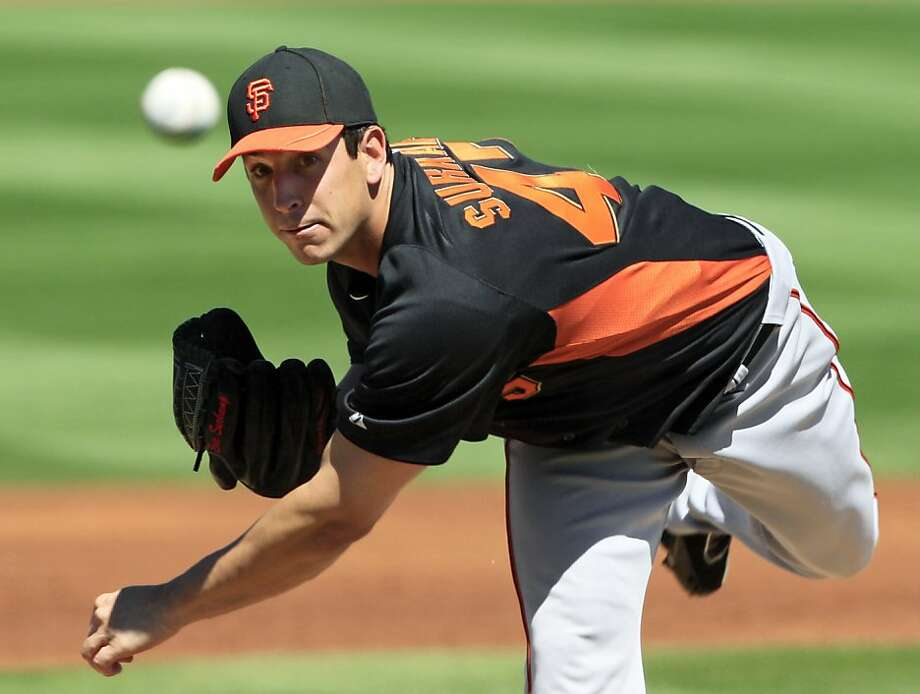 San Francisco Giants' Eric Surkamp pitches to the Cleveland Indians in the first inning of a spring training baseball game Wednesday, March 21, 2012, in Goodyear, Ariz. (AP Photo/Mark Duncan) Photo: Mark Duncan, Associated Press