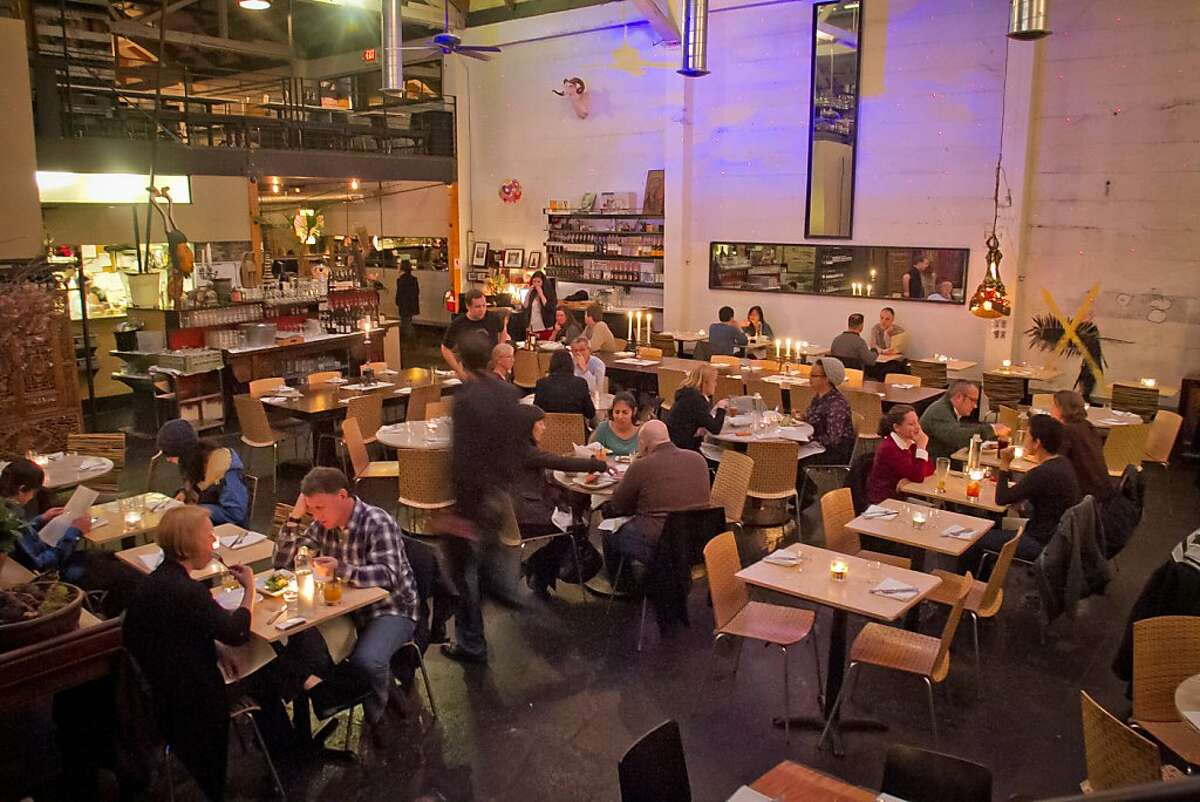 Diners enjoy dinner at Mua Restaurant in Oakland, Calif., on Wednesday, March 14th, 2012.