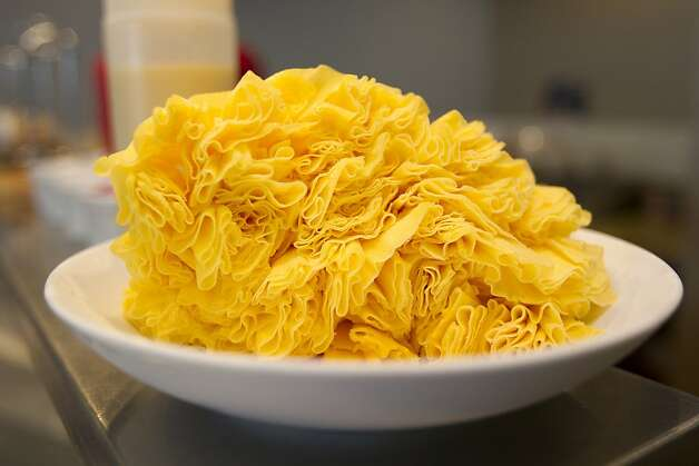 A mango-flavored shaved snow ready to be decorated at Snowflake in Pleasanton, Calif. on Thursday, March 15, 2012. Photo: Stephen Lam, Special To The Chronicle