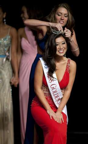 Sara Choi is crowned Miss Golden Gate on Sunday. Beauty Pageant contestants from across the Bay Area met at the Ruth Asawa School of the Arts, Dan Kryston Memorial Theater on Sunday for the annual Miss San Francisco preliminary competition for Miss California. Photo: Kevin Johnson, The Chronicle