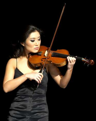 Sarah Choi plays the violin during the talent portion of the Miss San Francisco Beauty Pageant on Sunday. Beauty Pageant contestants from across the Bay Area met at the Ruth Asawa School of the Arts, Dan Kryston Memorial Theater on Sunday for the annual Miss San Francisco preliminary competition for Miss California. Photo: Kevin Johnson, The Chronicle
