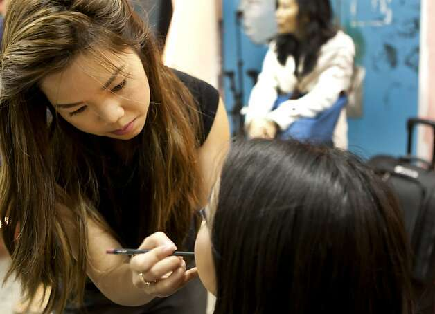 Van Pham, of Vanity Pham makeup, touches up a contestant on Sunday backstage at the Miss San Francisco pageant. Beauty Pageant contestants from across the Bay Area met at the Ruth Asawa School of the Arts, Dan Kryston Memorial Theater on Sunday for the annual Miss San Francisco preliminary competition for Miss California. Photo: Kevin Johnson, The Chronicle