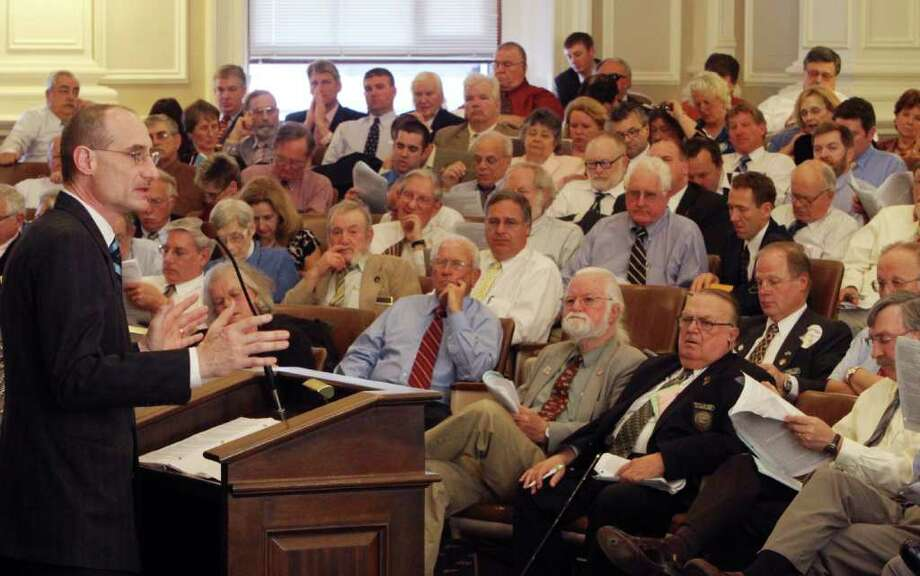 State Rep. David Bates, R-Windham, talks about his amendment on on a bill to repeal New Hampshire's gay marriage law and replace it with the civil unions law and putting question on the ballot asking voters if that is what they want. at the statehouse Wednesday, March 21, 2012 in Concord, N.H. (AP Photo/Jim Cole) Photo: Jim Cole