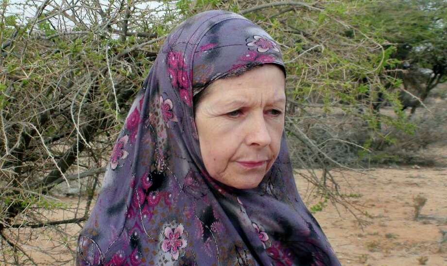 British tourist Judith Tebbutt, 56, who was snatched by Somali gunmen from a resort island in Kenya and whose husband David Tebbutt was killed in the attack, is seen after being freed following more than six months in captivity in Adado, Somalia Wednesday, March 21, 2012. (AP Photo) Photo: STR / AP