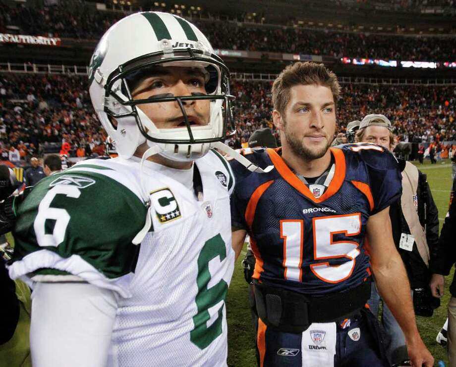 FILE - In this Nov. 17, 2011 file photo, New York Jets quarterback Mark Sanchez (6) and Denver Broncos quarterback Tim Tebow (15) walk off the field together after an NFL football game, in Denver. Tebow has been traded from the Denver Broncos to the New York Jets. (AP Photo/Barry Gutierrez, File) Photo: Barry Gutierrez