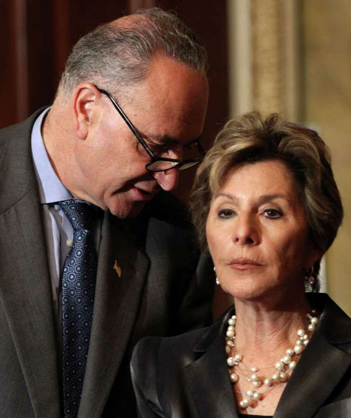 Sen. Charles Schumer, D-N.Y. talks with Sen. Barbara Boxer, D-Calif. during a news conference on Capitol Hill in Washington, Wednesday, March 21, 2012, to urge the House to pass a bipartisan transportation bill. (AP Photo/Jacquelyn Martin)