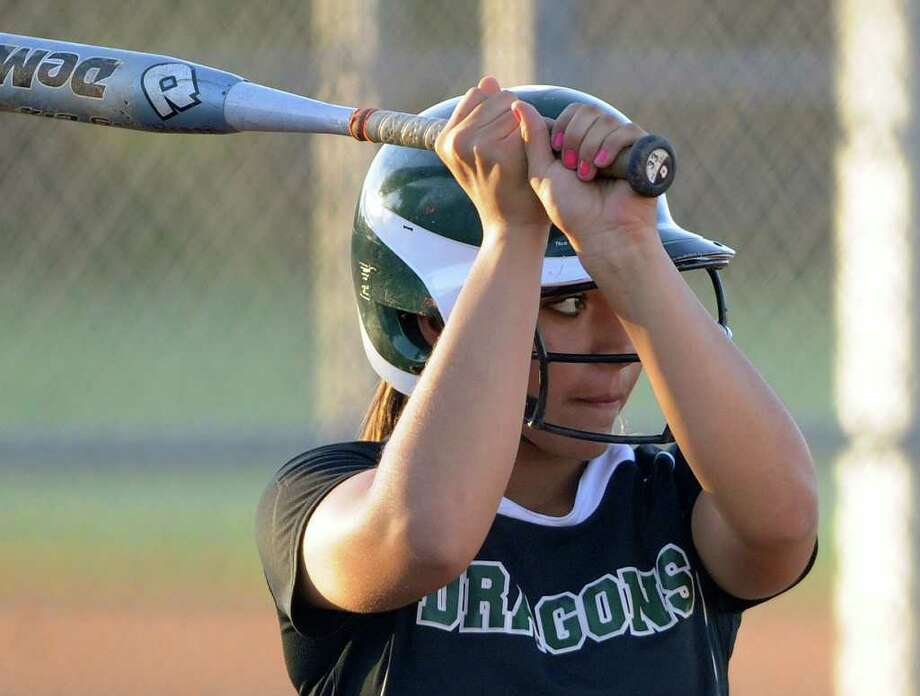 Kayla Arguelloa of Southwest watches for the pitch during softball action against East Central at East Central High School on Wednesday, March 21, 2012. Billy Calzada / San Antonio Express-News Photo: Billy Calzada, San Antonio Express-News / San Antonio Express-News