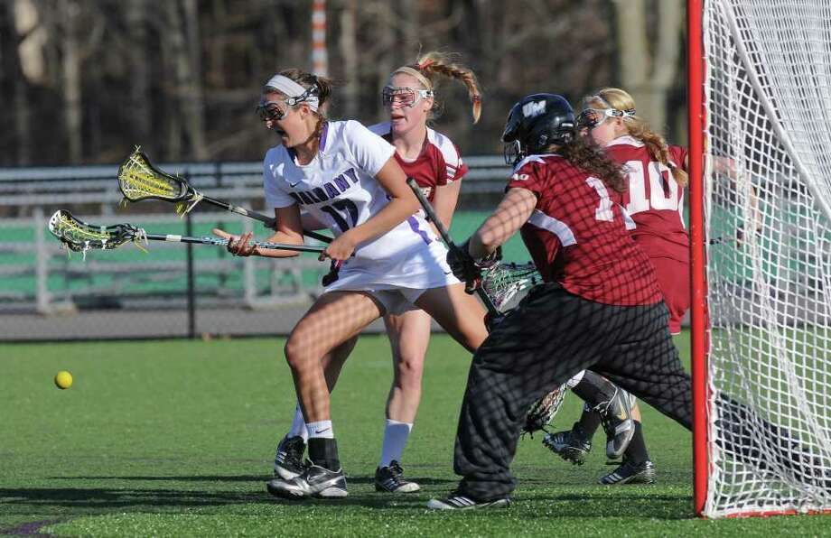 UAlbany lacrosse player Jess Antelmi, left, loses the ball near Massachusetts goalkeeper Katie Florence, right, during the first half of UAlbany's 12-11 overtime loss on Wednesday March 21, 2012 in Albany, N.Y.    (Philip Kamrass / Times Union ) Photo: Philip Kamrass / 00016906A