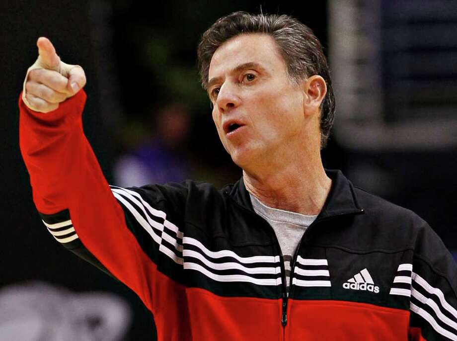 Louisville head coach Rick Pitino instructs his team during practice in Phoenix, Wednesday, March 21, 2012. Louisville will face Michigan State in an NCAA tournament West Regional semifinal college basketball game on Thursday. (AP Photo/Matt York) Photo: Matt York
