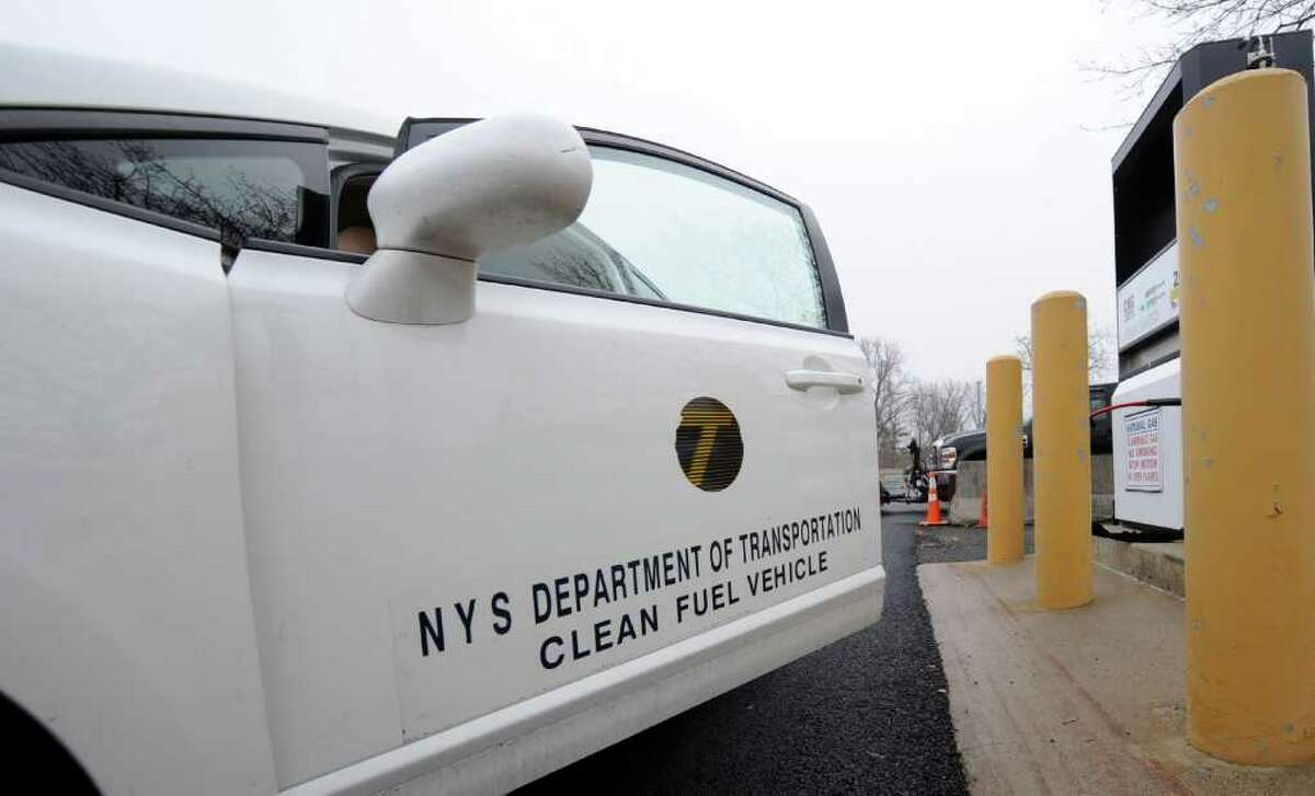 State employee Frank Bonesteel exits his CNG car at the natural gas filling station at the DOT lot on Route 155 in Latham, N.Y. March 21, 2012. (Skip Dickstein / Times Union)