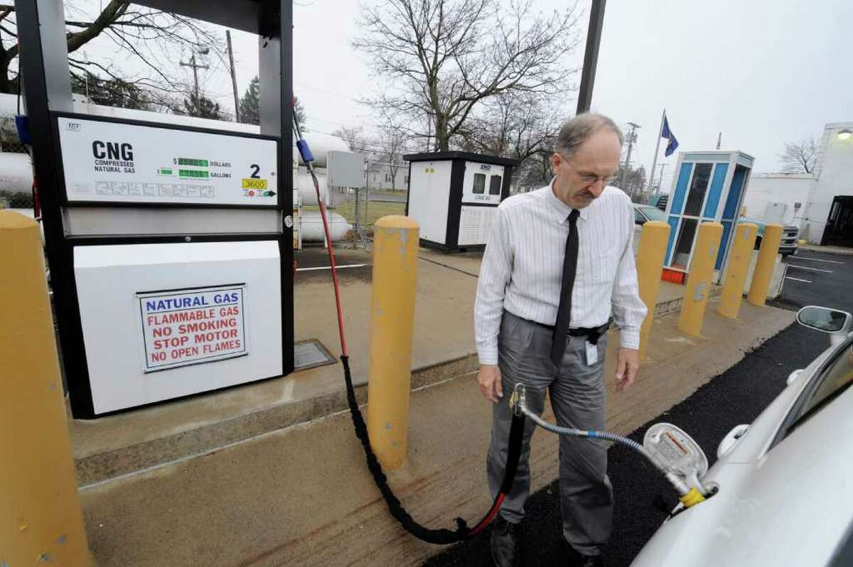 State employee Frank Bonesteel fuels his CNG car at the natural gas filling station at the DOT lot on Route 155 in Latham, N.Y. March 21, 2012. (Skip Dickstein / Times Union)